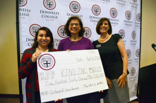 Donnelly College students presented a check for Kids in Need of Defense (supportkind.org).