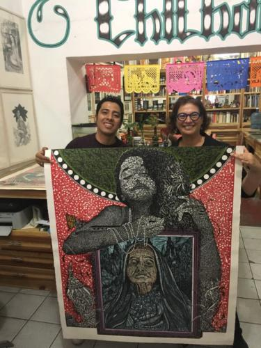 Sonia purchasing a piece of art by Mk Kabrito in Oaxaca, November 2018.