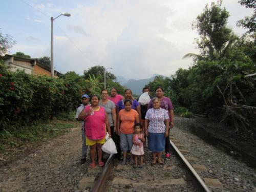 Standing on the tracks in Veracruz, Mexico, with Las Patronas, a group of now famous women who help migrants by hurling bags of food they have prepared for hungry migrants on top of freight trains journeying north.
