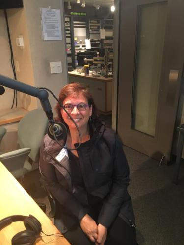 Sonia at the NPR studio in Champaign Urbana bright and early talking caravans and immigration, October 2018.